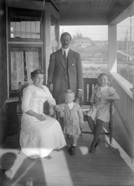 [Annie, John, Jack and Jean Davidson on porch of 2119 West 42nd Avenue]