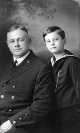 [Portrait of Capt. M. Uldall with a young boy]