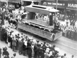 [B.C. Electric horse-drawn float in the 600 Block of Granville Street during a Victoria Day parade]