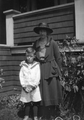 Grace Cornelia Ing and son in front of 3350 Manitoba St.