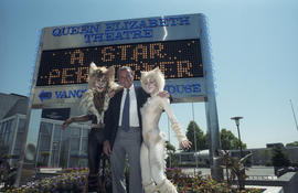 George Puil with Cats cast members in front of the Queen Elizabeth Theatre Bank of Montreal signb...