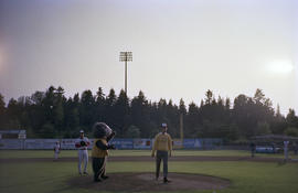 Tillicum on Nat Bailey field with [Gordon Campbell] and baseball players for Canadians Centennial...