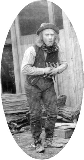 [Alfred T. Layne, actor, in role of old village idiot with shawl, different pose]
