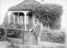 [Joe Fortes in front of his cottage at the foot of Bidwell Street (1700 Beach Avenue)]