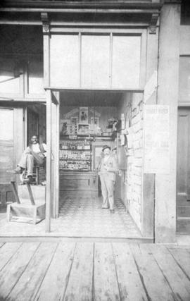 [Exterior of Fred Ackers - Tobacconist and shoeshine - 132 Cordova Street]