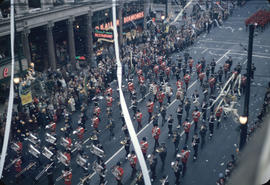 43rd Grey Cup Parade, on Granville Street at West Pender, military marching band, ticker tape, sp...