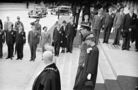 [Mayor and Mrs. Lyle J. Telford escort King George VI and Queen Elizabeth from City Hall]