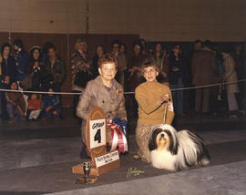 Group four [Terrier Group: Lhasa Apso] award being presented by judge J.S. Fletcher at 1973 P.N.E...