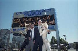 George Puil and unidentified man with Cats cast members in front of the Queen Elizabeth Theatre B...