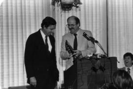 Daniel Colussy and Mike Harcourt at podium