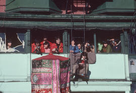 Spectators viewing the Chinese New Year parade from the second storey of 15 East Pender Street