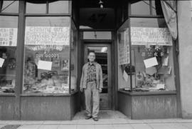 Owner Lin Bei-lian in front of Wing Hing Dry Goods Ltd., unit block  East Pender Street, on the e...