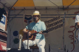 Guitarist performing on Chevron Stage