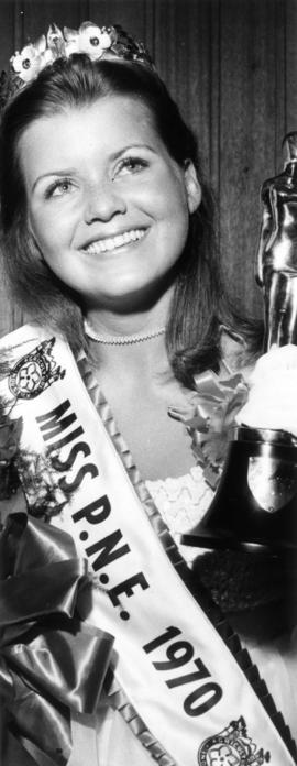Heather Kettleson, Miss P.N.E. 1970, posing with trophy