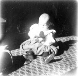 [Theodore Taylor, aged] 17 or 18 mo[nths, holding toy]