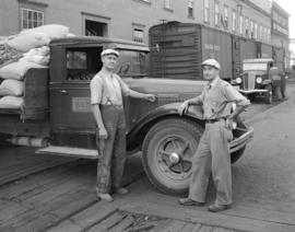[Two men beside a Brackman-Ker Milling Company truck]
