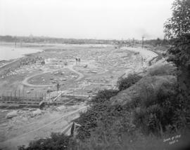 [Partially constructed Kitsilano Pool, showing excavation and construction of stone wall]