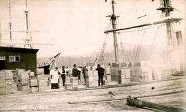 "[Cargo of tea on dock from the ""W.B. Flint""] 1st Tea Ship"