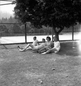 [Group sitting under a tree on Bowen Island]