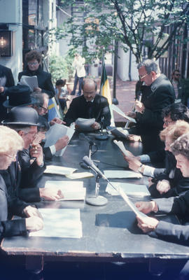 Mike Harcourt at head of table during reenactment of Vancouver's first City Council meeting