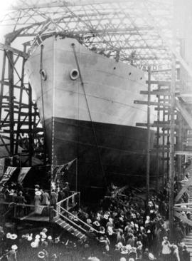"[A crowd gathered for the launching of the ""War Dog"" at Wallace Shipyards]"