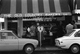Old Country Bakery front window with shoppers across Robson Street