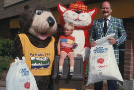 Tillicum and MacTavish with a child and Mayor Harcourt