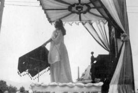 [A woman on a float in the Labour Day parade]