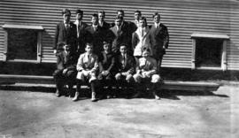 [Group portrait of boys in front of building]