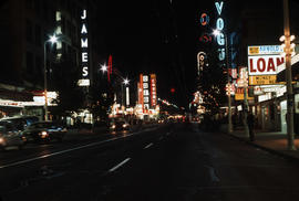 Granville Street at night looking north between Nelson and Smithe Streets
