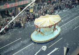 43rd Grey Cup Parade, on Granville Street, carousel float and spectators