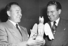[E.J. Irwin, Park Commissioner presents Jimmy McLarnin with a small totem pole, carved by Mrs. El...
