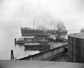 [The 'A.C. Rubel' tanker and other boats docked at the B.A. Oil Company refinery up Bur...