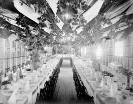 [A railway car decorated and lined with tables set for the luncheon of the official opening of th...