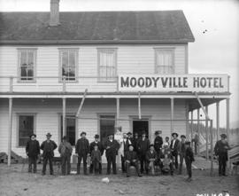 [People assembled outside the Moodyville Hotel]