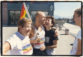 Nicholson Earle with mother and friend carrying rainbow flag