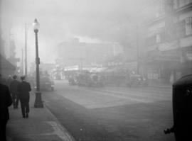 [Hastings Street and fire engines shrouded in smoke from fire at movie theatre]