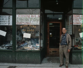 Wing Hing Dry Goods owner Lin Bei-lian standing at the front entrance to his shop