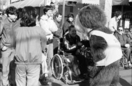 Tillicum interacting with man in wheelchair