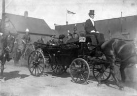 [The Duke and Duchess of Cornwalll and York in a carriage]