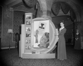 "[Woman standing by a ""T-Men"" movie display in the lobby of the Orpheum Theatre]"