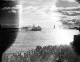 "[A crowd on the north side of the First Narrows watches the S.S. ""Marguerite"" heading t..."