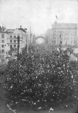 [View of Granville Street from the C.P.R. Station of crowds welcoming soldiers returning from the...