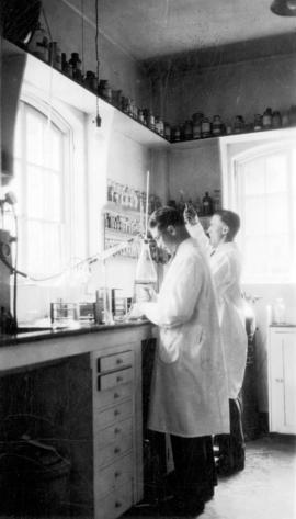 [Dr. Edward Matheson and Mr. Scott working in a laboratory at Vancouver General Hospital]