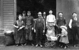 [Group portrait in front of Lobb and Muir Blacksmiths at 2410 Westminster Avenue (Kingsway)]