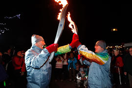 Unidentified torchbearers passing the flame [1 of 2]