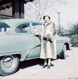 Antoinette Bentley standing beside Buick automobile at 1402 McRae Avenue