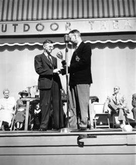 H.M. King presenting award on Outdoor Theatre Stage