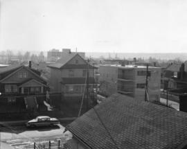 [View of houses and an apartment in the 2100 block 6th Ave West]