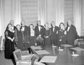 [Group portrait of Red Cross officials and members in formal attire at the Hotel Vancouver]